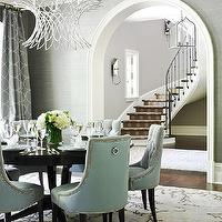 Traditional Home - dining rooms - bakers, turquoise, blue, tufted, dining chairs, nailhead trim, glossy, black, round, dining table, gray, grasscloth, wallpaper, gray, turquoise, blue, circles, drapes, white, wire, chandelier, arched doorway, vines, rug, dining chairs, tufted dining chair, velvet dining chairs, velvet tufted dining chair, blue dining chair, blue tufted dining chair, Tissage Chandelier, Urban Electric Co. Olga Sconce,
