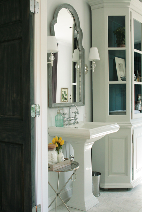bathrooms - light blue walls white bathroom cabinet glossy white pedestal sink white washed arched mirror tripod tray table  southernexposure1.squarespace.com