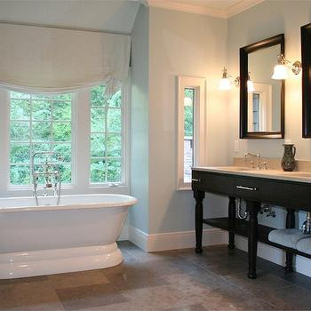 Dresser Homes - bathrooms - double bathroom vanity, double sinks, black beveled mirrors, beveled mirrors, black double vanity, freestanding tub, blue walls,
