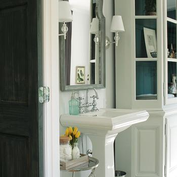 Chic master bathroom design with white bathroom cabinet, glossy white pedestal ...