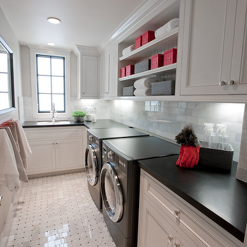 Spinnaker Development - laundry/mud rooms - black washer and dryer, laundry room, laundry room ideas, black and white laundry room, laundry room shelving, laundry room shelves, long laundry room, narrow laundry room,