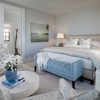 Summer House Style - bedrooms - blue bench, tufted bench, blue tufted bench, upholstered bed, light blue walls, light blue bedroom walls, low coffee table, bedroom sitting area, white floor mirror, white lacquer floor mirror, lacquer floor mirror, gray walls, gray paint colors,