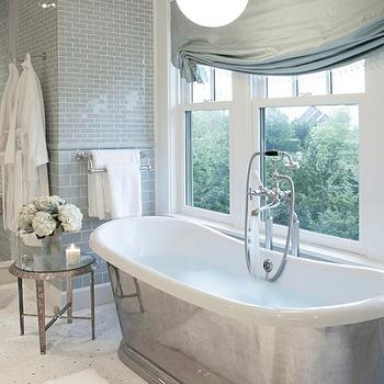 Mabley Handler - bathrooms: turquoise bathroom, turquoise blue bathroom, turquoise subway tiles, turquoise roman shade, turquoise blue roman shade, candide tub, waterworks bathtub, bathroom lanterns, pendant over bathtub, blue subway tile,