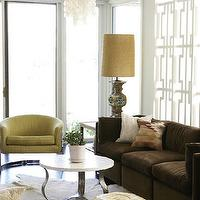 Angie Hranowski - living rooms - Hollywood Regency, brown and yellow living room, brown sofa, 3 cushion sofa, brown 3 cushion sofa, yellow chairs, yellow accent chair, room partition, geometric room partition, white room partition, hollywood regency living room, white cowhide rug,