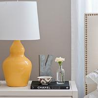 A cup of Mai - bedrooms - yellow and gray bedroom, gray and yellow bedroom, gray and yellow bedrooms, yellow and gray bedroom design, gray and yellow, yellow and gray, headboard in front of window, white nightstands, yellow lamps, white headboard, studded headboard, headboard with brass trim,