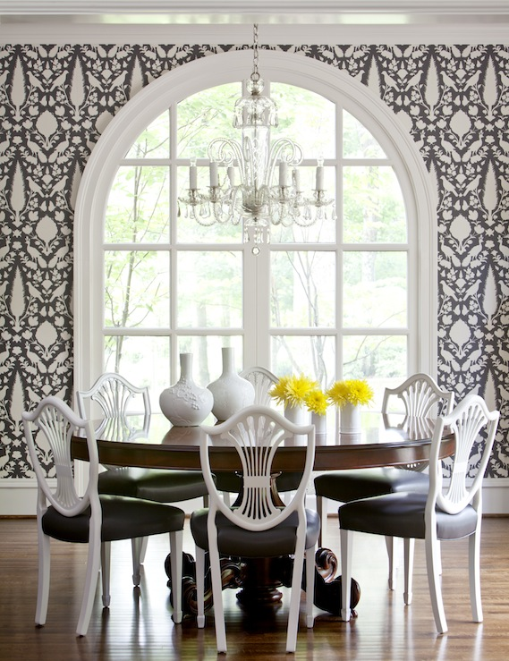 dining rooms - Schumacher Chenonceau wallpaper - charcoal cherry round pedestal dining table white Swedish Gustavian shield back chairs black cushions
