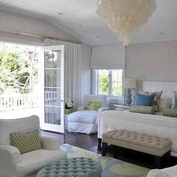Giannetti Home - bedrooms - capiz chandelier, white capiz chandelier, white headboard, blue table lamp, blue triple gourd lamp, tufted bench, beige tufted bench, oval ottoman, turquoise tufted ottoman, oval tufted ottoman, bedroom sitting area, Oly Studio Serena Chandelier,
