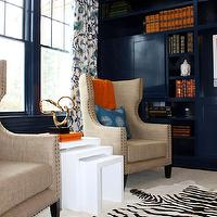 Porter Design Company - dens/libraries/offices - blue, walls, moldings, built0ins, mushroom, linen, studded, wingback, chairs, white, zebra, cowhide, rug, white, modern, nesting, tables, orange, accents, nesting tables, white nesting tables,