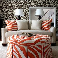 Porter Design Company - living rooms - red, zebra, round, skirted, storage, tufted, ottoman, black, gourd, lamps, brown, floral, wallpaper, red, zebra, pillows, glossy, black, gourd, lamps, coffered ceiling, sisal, rug,