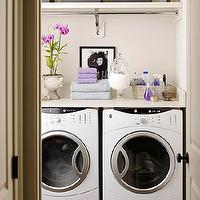 BHG - laundry/mud rooms - ivory, walls, white, washer, dryer, lilac, purple, towels, gray, storage, linen, boxes,  Lovely laundry room design