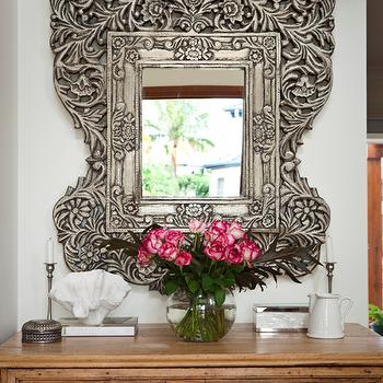 Porchlight Interiors - entrances/foyers - ornate mirror, ornate metal mirror,  Chic foyer vignette with hand carved mirror and vintage chest