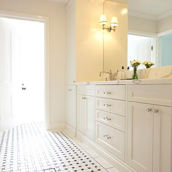 Beautiful bathroom design with basketweave tiles floor, creamy white shaker ...