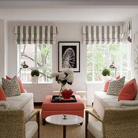 Lynn Morgan Design - living rooms - pink ottoman, coral pink ottoman, face to face sofas, sofas facing each other, ottoman coffee table, striped roman shade, coral pink pillows,