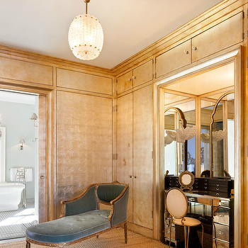 Nate Berkus Design - closets - mirrored vanity, closet chaise lounge, chaise lounge in closet, blue chaise lounge, velvet chaise lounge, blue velvet chaise lounge, vanity nook, vanity alcove, alcove vanity, gold walls, gold wall treatments, walk in closet, luxurious closet,
