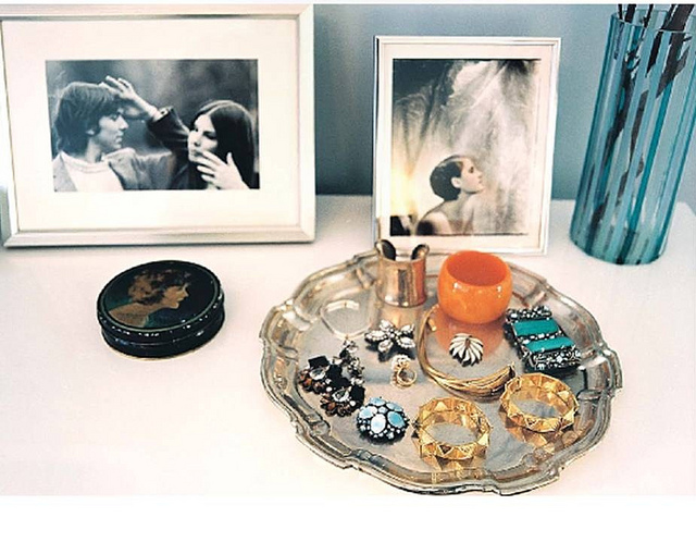 closets - vignette silver tray silver picture frames  Lonny Mag  Vignette with silver picture frames and silver jewelry tray.