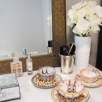 Live Creating Yourself - closets: tea cup jewelry bowls, tea cups as jewelry bowls,  Beautiful vignette with gold mirror, white vase, bows used