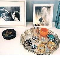 Lonny Magazine - closets - vignette, silver, tray, silver, picture frames,  Vignette with silver picture frames and silver jewelry tray.
