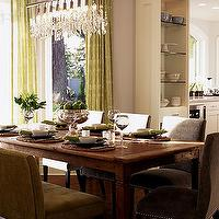 dining rooms - chairs, table, chadelier,  a well used table mixed with sparkly chandy, a upholstered chairs.