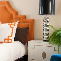 Marmalade Interiors - bedrooms - greek key shams, white and orange shams, orange headboard, orange velvet headboard, orange and brown bedding, white lacquer cabinet,