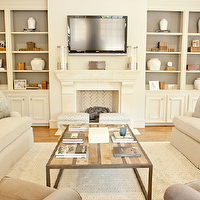 Munger Interiors - living rooms - ivory, built-ins, limestone, fireplace, herringbone, firebox, diamond, patterned, rug, ivory, sofas, silver, blue, damask, pillows, gray, damask, pillows, milk chocolate, brown, velvet, chairs, flatscreen tv, fray, drapes, built-in cabinets, built-ins, living room built-ins, ivory built-ins, ivory built-in cabinets, built-in bookcase, living room bookcase, fireplace built-ins, fireplace built-in bookcase, fireplace bookcase, floor to ceiling built-ins, floor to ceiling built in cabinets, floor to ceiling built in bookcase,