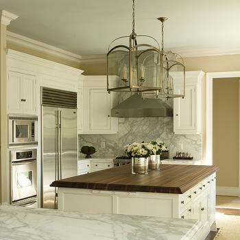Tracy Morris Design - kitchens - two tone countertops, butcher block island, butcher block countertops, white marble countertops, dining nook, dining bench, arch lantern, kitchen island lanterns,