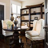Paul Corrie Interiors - dens/libraries/offices - espresso, round, pedestal, table, white, wingback, slipcovered, chairs, black, front door, greige, walls, beige walls, beige paint, beige paint color, beige office walls, beige office paint, beige office paint color, Pottery Barn Rhys Bookcase,