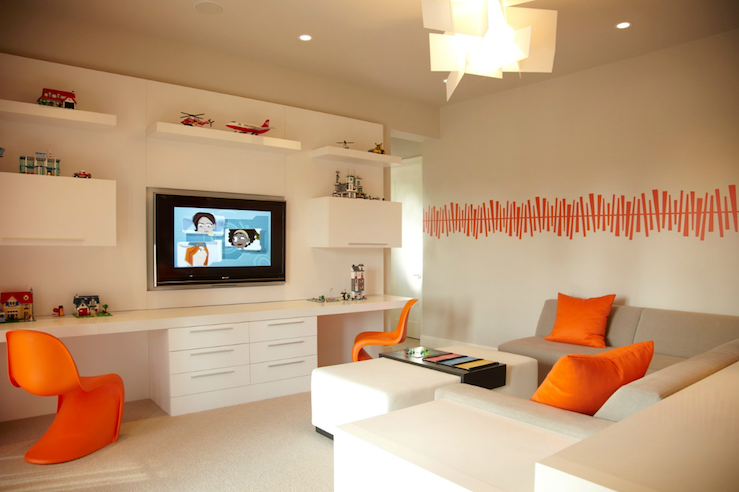 B and G Design - boy's rooms - Tangerine Panton Chair, shared desk, boys shared desk, kids shared desk, floating desk, panton chairs, orange panton chairs, tv niche, builtin tv niche, gray sectional, orange pillows, gray and orange kids room, gray and orange playroom,