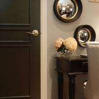 A Well Dressed Home - entrances/foyers - Benjamin Moore - Dragons Breath - black, door, black, desk, West Elm, convex, mirrors, linen, chair, nailhead trim, black walls, black paint, black paint color,