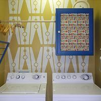 laundry/mud rooms - Valspar - Golden Popover (walls) and La Fonda Deep Blue (cabinet) - clothespins, stencil, small spaces, laundry, closet, fabric door, blue, patterns,