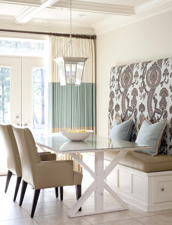 dining rooms - Sherwin Williams - Wool Skein - Circa Lighting Small Cornice Hanging Lantern F Schumacher Shalkar - Sepia coffered ceiling tan walls white trestle dining table blue pillows camel leather cushion two-tone ivory seafoam green drapes camel leather arm chairs