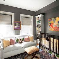 Erin Gates Design - nurseries - gray, walls, white, bookshelves, Ikea, pelt, white, sofa, pink, yellow, pillows, linen, roman shades, black, ribbon trim, abstract, painting, art, gray walls, gray paint, gray paint colors, charcoal gray walls, charcoal gray paint, charcoal gray paint color, charcoal gray nursery walls, charcoal gray nursery paint, charcoal gray paint color, Madeline Weinrib Atelier Indigo Brook Rug, Dream On Me Jenny Lind Classic Crib - Black,