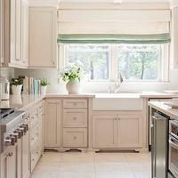 Tobi Fairley - kitchens - white, porcelain, apron, farmhouse, sink, ivory, off-white, shaker, kitchen cabinets, gray, green, faux finish, kitchen island, Silestone, quartz, countertops, coffered ceiling, ivory, seafoam, green, silk, roman sahdes,