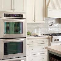 Tobi Fairley - kitchens - ivory, shaker, kitchen cabinets, quartz, countertops, glossy, subway tiles, backsplash, pot filler, Kitchen Aid, warming drawers, Kitchen Aid, double ovens,