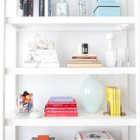 The Coveteur - dens/libraries/offices - vignette, blue, boxes, books,  whowhatwear.com - Gorgeous vignette with blue boxes, books, baby blue