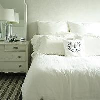 In the Fun Lane - bedrooms - monochromatic, white, damask, walls, white, vintage, dresser, white, mirror, glass, column, lamp, white, bedding, crystal chandelier,