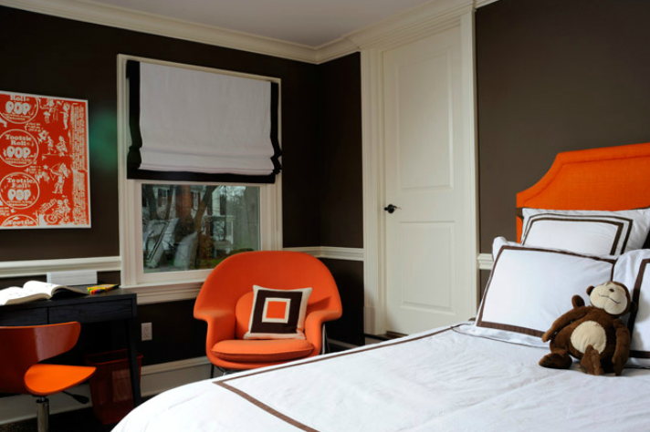 boy's rooms - Eero Saarinen Womb Chair orange headboard chocolate brown walls chair rail white roman shade chocolate brown ribbon trim white hotel bedding chocolate brown stitching ebony wood modern desk orange plastic task chair orange black squares pillow