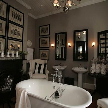 John Jacob Interiors - bathrooms - bathroom fireplace, fireplace in bathroom, soaking tub, bathtub in front of fireplace, tub in front of fireplace, black fireplace, his and her sinks, his and her pedestal sinks, black mirrors, his and her mirrors, taupe walls, bathroom art,