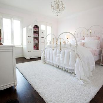Jennifer Backstein Interiors - girl's rooms - iron bed, shag carpet, chandelier, armoire, white iron bed, toy armoire, pink walls,  Gorgeous