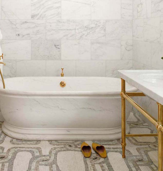 The Greenwich Hotel - bathrooms - mosaic tile, mosaic tile floor, mosaic tiled bathroom floor, mosaic tile bathroom, soaking tub, brass washstand, antique brass washstand,