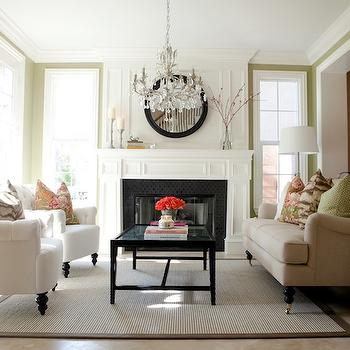 Belmont Design Group - living rooms - chandelier over coffee table, chandelier above coffee table, black coffee table, white tufted chairs, bound sisal rug, beige sofa, fireplace millwork, Z gallerie Palmer Stool,