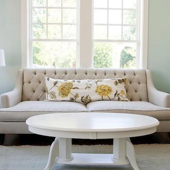 Caitlin Creer Interiors - living rooms - palladian blue, oval coffee table, white oval coffee table, beige sofa, beige tufted sofa, Pottery Barn Blue Smoke Fringed Hand-Loomed Rug, F Schumacher Avebury Floral Vine in Citrine, Worlds Away Tess Side Table,