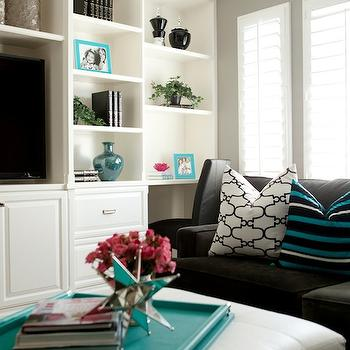 Belmont Design Group - living rooms - built ins, built in cabinets, living room built ins, living room built in cabinets, built in media cabinet, media cabinet, charcoal gray section, turquoise accents, turquoise blue accents, ottoman coffee table, turquoise tray, Windsor Smith Riad,