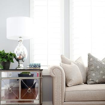 Belmont Design Group - living rooms - mirrored cabinet, mirrored end table, rolled arm sofa, studded sofa, studded rolled arm sofa, sofa with nailhead trim, light beige sofa, Amelie Two-Door Mirrored Chest,