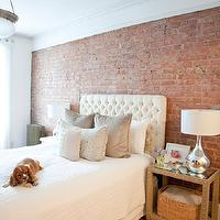 The Elegant Abode - bedrooms - exposed brick wall, white, tufted, headboard, gray, velvet, pillows, gray, rug, beige, faux croc, studded, nightstands, silver, lamps, velvet tufted headboard, white velvet headboard, white velvet headboard, white tufted headboard, white velvet tufted headboard,