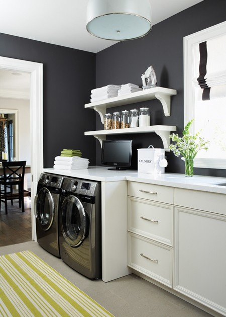 House &amp; Home - laundry/mud rooms - navy blue, walls, white, yellow, striped, runner, washer, dryer, white, cabinets, white, shelves, white, corbels, white, quartz, countertops, white, roman shade, navy blue, ribbon trim, laundry shelves, laundry room shelves, laundry room shelving, laundry room shelf,