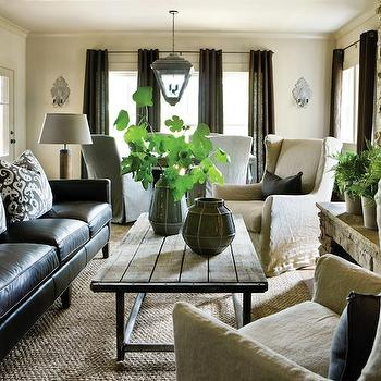 Atlanta Homes & Lifestyles - living rooms: industrial coffee table, black sofa, leather sofa, black leather sofa, reclaimed wood coffee table, wingback chairs, slipcovered wingback chairs,