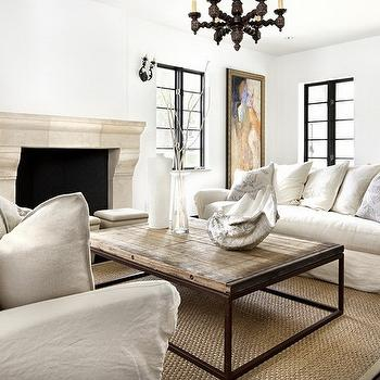 Simple Everyday Glamour - living rooms - industrial coffee table, french industrial coffee table, limestone fireplace, slipcovered sofas, face to face sofas, sofas facing each other,