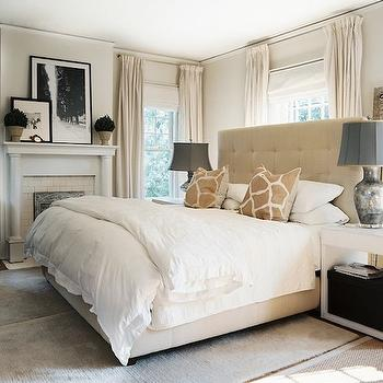 Lonny Magazine - bedrooms - beige headboard, beige tufted headboard, bedroom fireplace, fireplace in bedroom, giraffe pillows, bed in front of window, headboard in front of window, Giraffe Pillow,