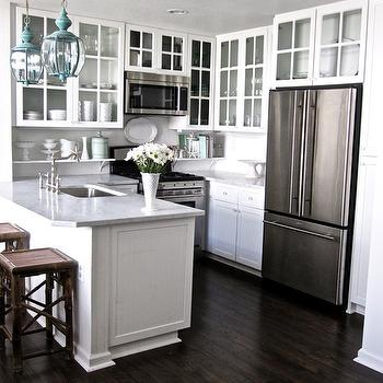 Grace Happens - kitchens - glass front upper cabinets, white kitchen cabinets, white marble countertops, turquoise lanterns, turquoise blue lanterns,