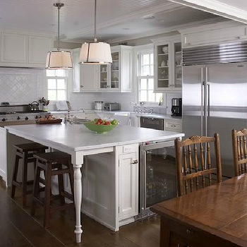 Freeman Design Group - kitchens - island mini fridge, glass front mini fridge, kitchen island mini fridge, kitchen island with legs, kitchen island with carved legs, chase pendants, white kitchen cabinets, white marble countertops, Robert Abbey Chase Pendant,